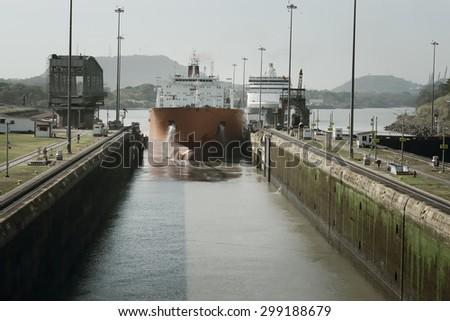 Large cargo ship entering Miraflores Locks at Panama Canal, Panama - stock photo