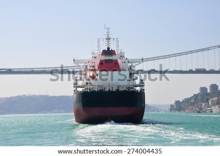 Large Cargo Tank passing the golden Horn and bosphorus bridge, Istanbul, Turkey - stock photo