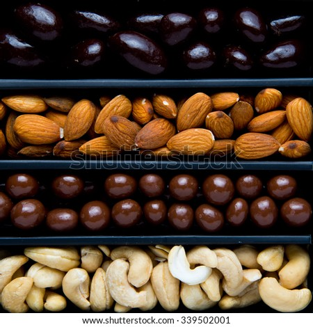 Large cashews and almonds,with Giffoni hazelnuts in Belgian milkchocolate and Brazils in dark Belgian chocolate. - stock photo