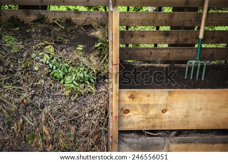 Large cedar wood compost boxes with composted soil and yard waste for backyard composting - stock photo