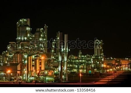 Large chemical production facility at night - stock photo