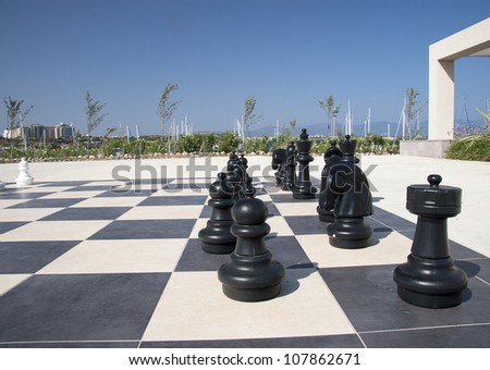 Large chess game on ground in the park - stock photo