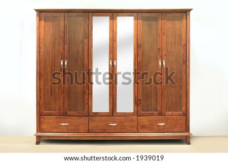 Large chestnut brown, rubber-wood, six door wardrobe with mirrors - stock photo