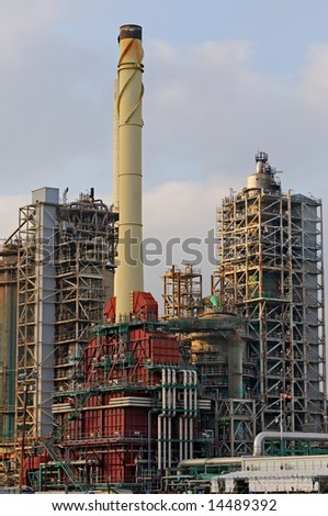 Large chimney and chemical installations in maintenance period - stock photo