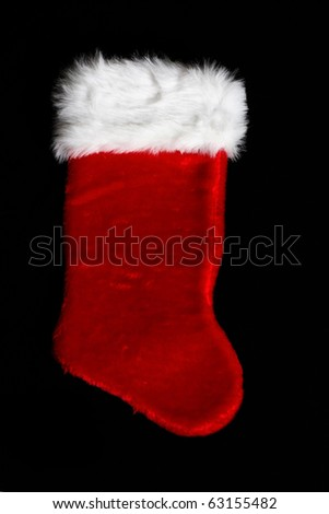 Large Christmas stocking on black background - stock photo