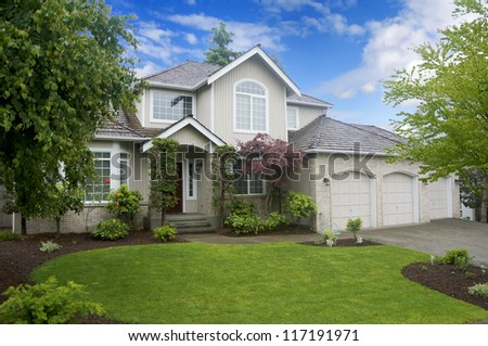 Large classic American house with three car garage. - stock photo