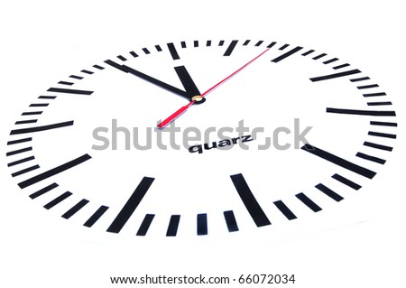 Large clock shows five minutes to twelve