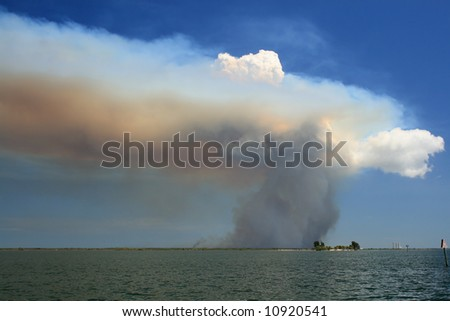 Large cloud of smoke from brush fire on Merritt Island, FL near the Kennedy space center - stock photo