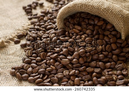 large coffee beans on sackcloth