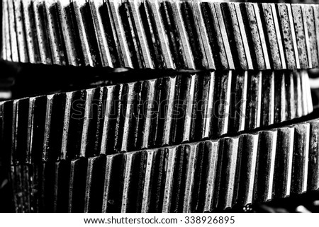 Large cog wheels in the factory for background, Center focus.Black and white photo.