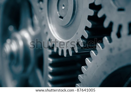 Large cog wheels in the motor. - stock photo