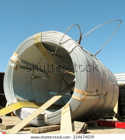 Large coil of metal wire - stock photo