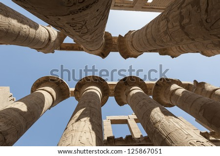 Large columns in hypostyle hall at the ancient temple of Karnak Luxor