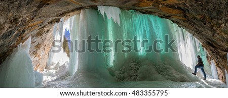 Large columns of ice forming across a cave opening on Grand Island, Lake Superior near Munsing, Michigan.