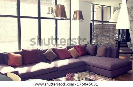 large comfortable living room with lots of lights - stock photo