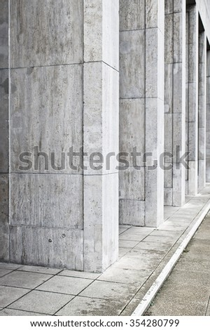 Large concrete pillars at the base of an urban building - stock photo