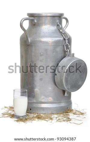 large container and glass of milk - stock photo