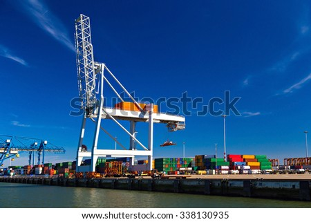 Large container cranes in Port of Rotterdam, Netherlands - stock photo