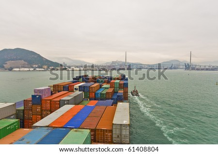 large container ship approaching Stone cutters Bridge, Rambler Channel, HONGKONG - stock photo