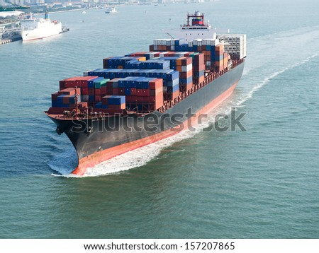 Large container ship arriving in port. - stock photo