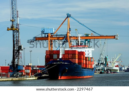 Large container ship, fully loaded, in Antwerp docks (brand names and logos have been systematically removed) - stock photo