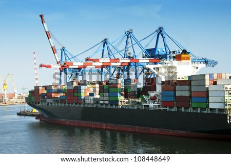 Large container ship in a dock - stock photo