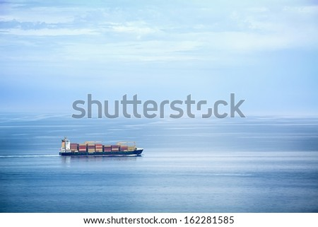 Large container ship in the open sea - stock photo