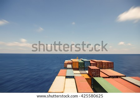 Large container ship move forward to ocean.