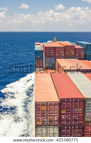 Large container ship move forward to ocean. - stock photo
