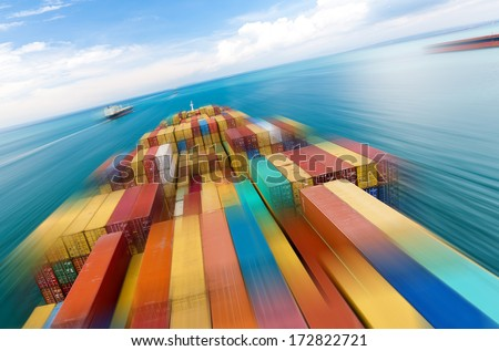 Large container vessel ship and the horizon, motion blur