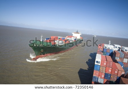 large container vessel ships at close encounter,  no logos in this picture - stock photo