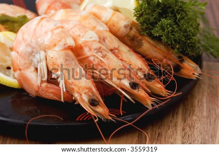 large cooked shrimps in shell served on plate - stock photo