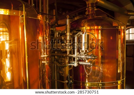Large, copper container for whisky, many reflections of light. - stock photo