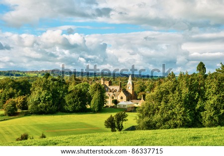 Large country house set in parkland - stock photo