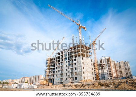 Large crane and construction of building - stock photo