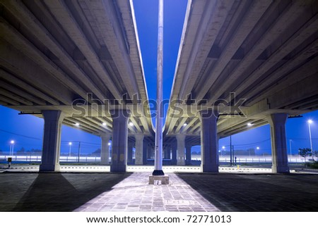 Large crossing elevated traffic highway in the night time - stock photo