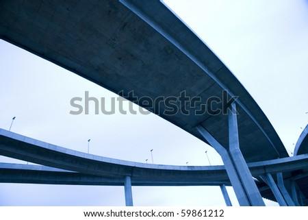 LARGE crossing highway overhead - stock photo