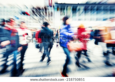 Large Crowd Walking in a City - stock photo