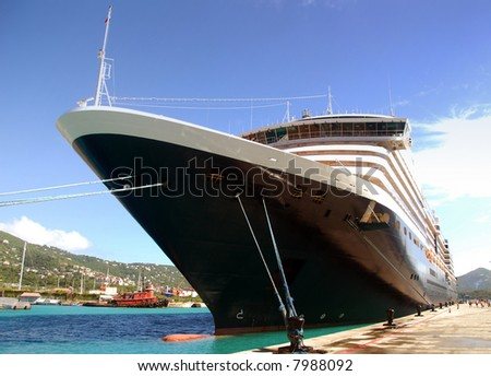 Large cruise liner in exotic port - stock photo