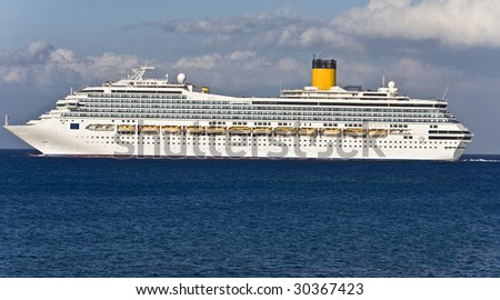 Large cruiser sailing outside Rhodes island in Greece at summer time - stock photo