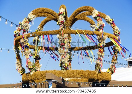 Large, decorated harvest crown on display at a fair in Bavaria, Germany. Harvest Crowns are typical items for German Thanksgiving - stock photo