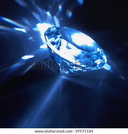 Large diamond jewel with reflections on black background - stock photo