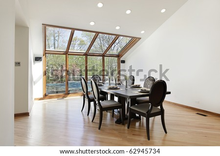 Large dining room with wood trimmed skylights - stock photo