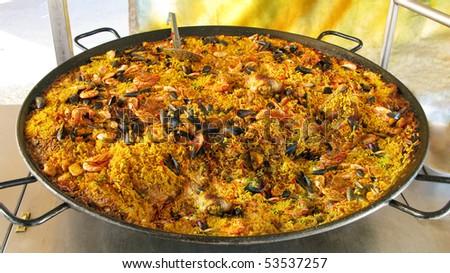 large dish of paella - stock photo