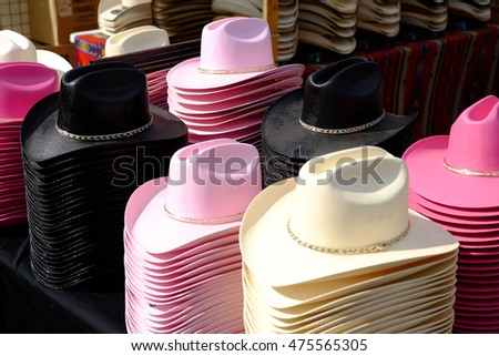 Large display of colorful cowboy hats.