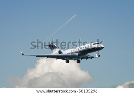 Large double engine business jet landing - stock photo