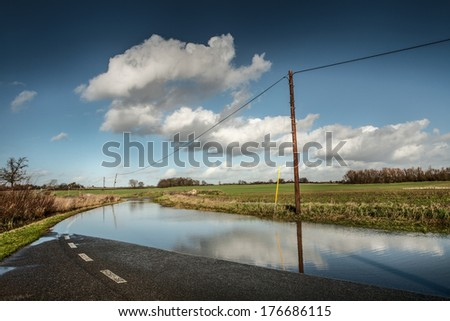 large downpour of rain has flooded the roads in essex england - stock photo