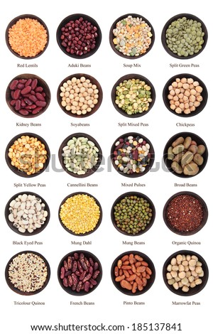 Large dried pulses selection in wooden bowls over white background with titles. - stock photo