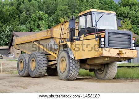 Large dump truck - earthmover on a construction site. - stock photo