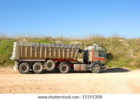 Large dump truck in construction site - stock photo